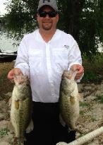 Jeff Chapman with 2 nice bass from his 3 fish stringer that helped him take 1st place and Big Bass at the May tournament on Lake Lewisville!!